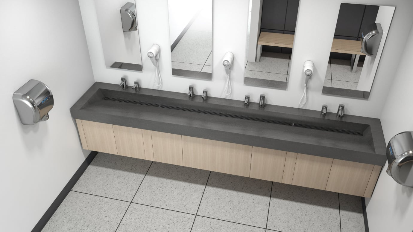 Aerial view of public restroom sink area with sensor faucets and hand dryers installed