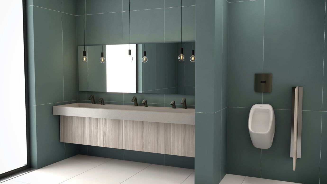 View in public restroom, sensor flushometer and faucets both in graphite finish in view