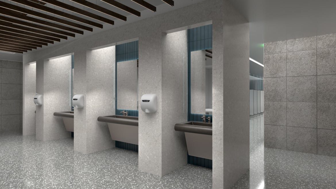 Angle view of restroom in an airport, sensor faucets and hand dryers in view